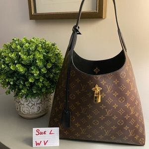 Authentic Flower Hobo bag by Louis Vuitton